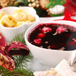 Stock Photo: Red borscht with mushroom ravioli for christmas eve