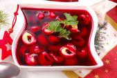 Red borscht with mushroom ravioli for christmas eve — Stock Photo