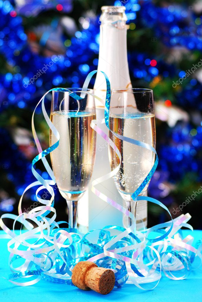 Two glasses with champagne on blue lights background — Stock Photo #3919084
