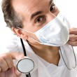 Stock Photo: Medic with stethoscope and medical mask.