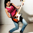 Female playing electric guitar — Stock Photo #2804195