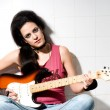 Female playing electric guitar — Stock Photo