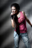 Female singin rock music — Stock Photo