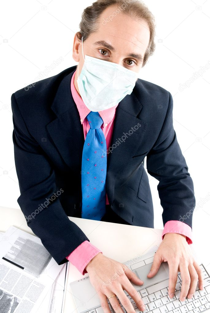 Businessman with medical mask for Flu prevention at work.  — Stock Photo #2802060