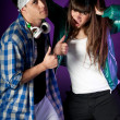 Young urban couple dancers on dark purple light — Stock Photo