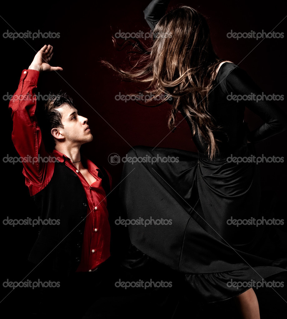 High contrast Young couple passion flamenco dancing on red light background.  Stock Photo #3205176