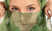 Young arab woman with veil showing her eyes isolated on white background — Stock Photo