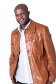 Handsome black man with leather jacket isolated on white background — Stock Photo
