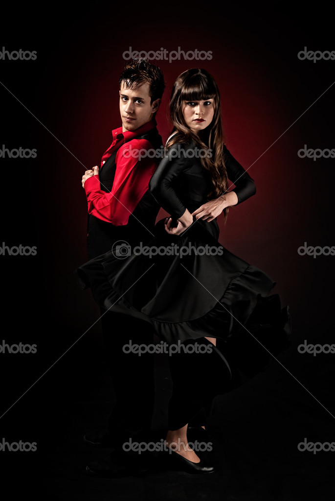 High contrast Young couple passion flamenco dancing on red light background. — Stock Photo #3526417