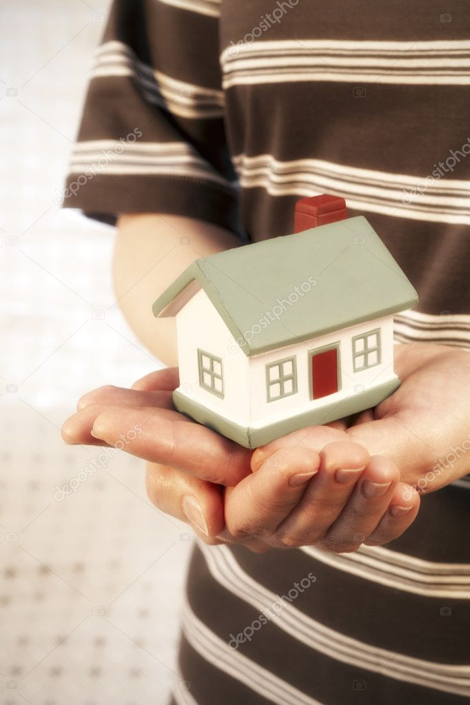 The house in human hands — Stock Photo #2747390