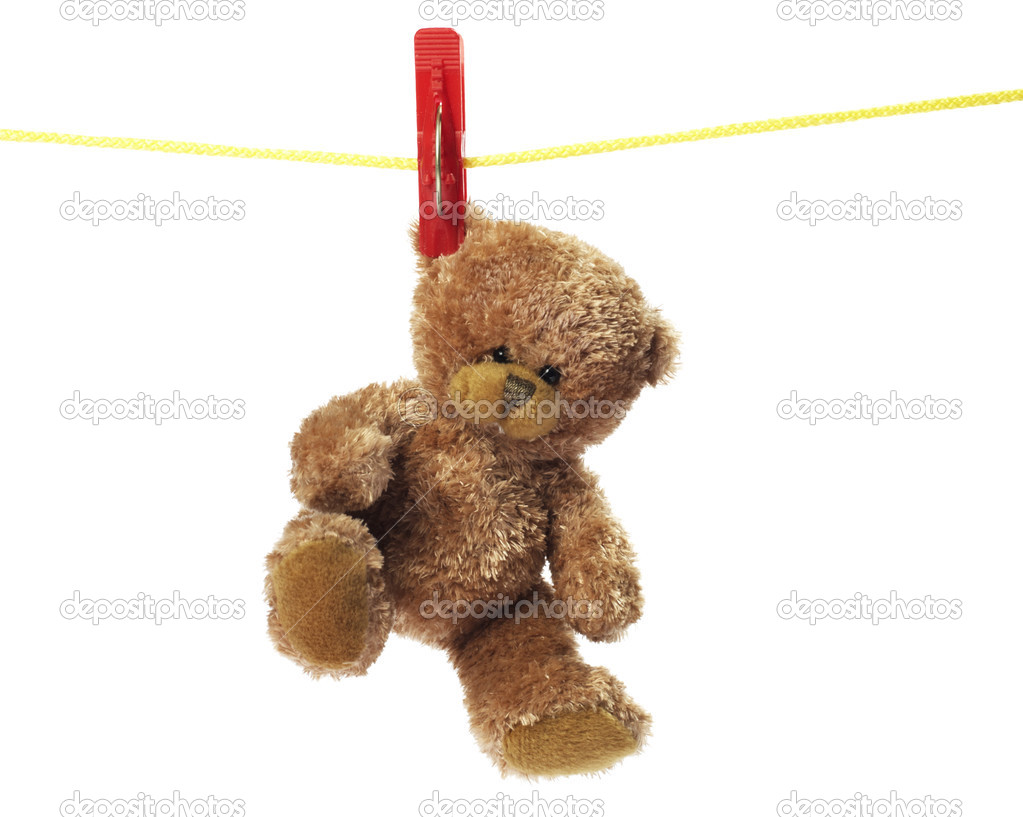 Teddy bear toy hanging on pegs on a rope on a white background — Stock Photo #2748802