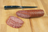Sausage and a knife — Stock Photo