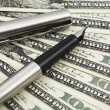 Stock Photo: Pen and dollar