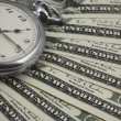 Stock Photo: Pocket watch on US currency