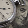 Pocket watch on US currency - Stock Photo