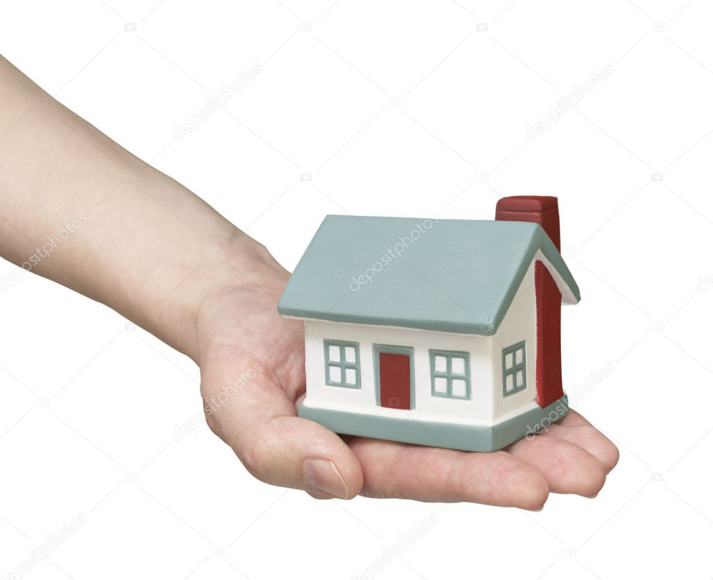 The house in human hands, isolated on white with clipping path. — Stock Photo #3298721