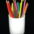 Colored pencils and pens in a jar agains — Stock Photo #2797778