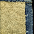 Royalty-Free Stock Photo: Denim Jacket Pocket Detail with Sheep Sk