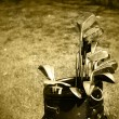 Stock Photo: Old set of rough used golf clubs sepia i