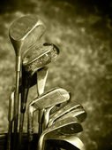 Old set of rough used golf clubs — Stock Photo
