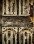 Old rusty wooden gothic door detail — Stock Photo