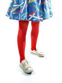 赤いタイツ姿の若い女の子の足 — ストック写真