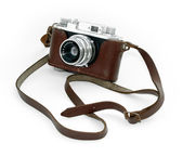 Old vintage camera in a leather case aga — Stock Photo