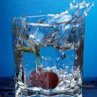 Cherry splashed into water — Stock Photo
