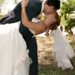 Stok fotoğraf: Kiss of groom and bride