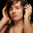 Girl in headphones enjoying music — Stock Photo