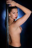 The girl dances a striptease — Stock Photo