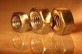 Three gold nuts. — Stock Photo