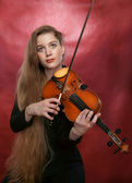The girl and a violin — Stock Photo