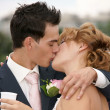 Stock Photo: Kiss of the groom and the bride