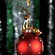 New Year's sphere on a fur-tree - Stock Photo