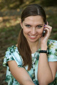 The girl speaks on the phone — Stock Photo