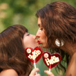Foto Stock: Two beautiful sexual girls kiss
