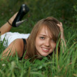 The beautiful girl on a green grass — Stock Photo