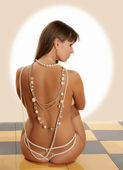 Pin-Ap the girl with a naked back — Stock Photo