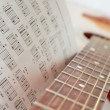 Royalty-Free Stock Photo: An acoustic guitar with a book of chords