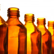 Stock Photo: Row of medicine bottle