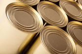 Tinned food. Row of metal cans with no label — Stock Photo