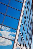 Reflexion of clouds in building windows — Stock Photo