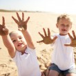 Sandy beach kids — Stock Photo