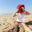 Royalty-Free Stock Photo: Young photographer with bright red camera