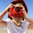 Young photographer with bright red camera — Stok fotoğraf