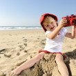 Stock Photo: Young photographer with bright red camera