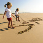 Kids writing in sand — Stock Photo