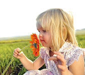 Smelling flowers — Stock Photo