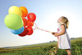 Colorful balloon girl — Stock Photo